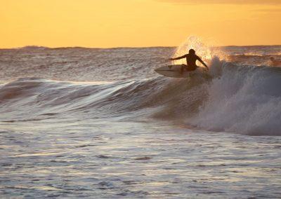 Surfer ON Wave With Orange Background