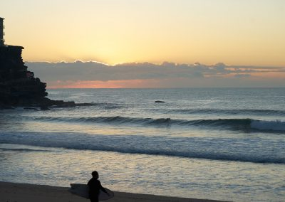 Queenscliff Beach Morning With Surfers Heading to the Water